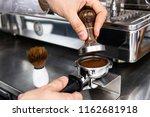 barista pressing ground coffee... | Shutterstock . vector #1162681918