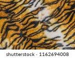 tiger patterned background   Shutterstock . vector #1162694008