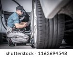 used car under maintenance.... | Shutterstock . vector #1162694548