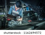 Car Mechanic Detailed Vehicle Inspection. Auto Service Center Theme.  - stock photo