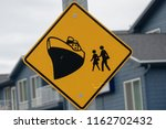 Road sign warns drivers of cruise ship passenger crossing in the cruise port town of Seward, Alaska