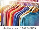 sweaters on a hanger in a store | Shutterstock . vector #1162740865