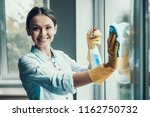 young smiling woman washing...   Shutterstock . vector #1162750732