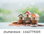 miniature colorful house on... | Shutterstock . vector #1162779205
