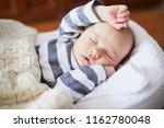 adorable baby girl sleeping in... | Shutterstock . vector #1162780048