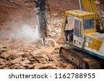 stone jacking machine at... | Shutterstock . vector #1162788955