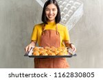 young woman holding tray with... | Shutterstock . vector #1162830805
