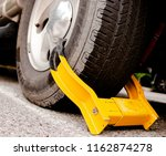 car wheel tire with yellow boot ... | Shutterstock . vector #1162874278