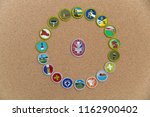 Small photo of SAINT LOUIS, UNITED STATES - AUG 22, 2018: A circular arrangement of Boy Scouts of America (BSA) merit badges with Eagle badge on cork background