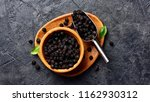dried cherry in wooden bowl on... | Shutterstock . vector #1162930312