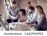 group of business people... | Shutterstock . vector #1162934902