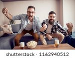friends celebrating a goal... | Shutterstock . vector #1162940512
