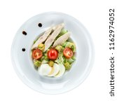 caesar salad with chicken over... | Shutterstock . vector #1162974052