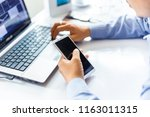 business men are using to... | Shutterstock . vector #1163011315
