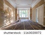 renovation concept   ladder in... | Shutterstock . vector #1163020072