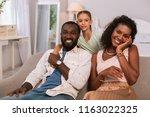 happy family. positive nice... | Shutterstock . vector #1163022325