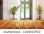 wood table on blur background... | Shutterstock . vector #1163022922