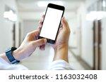 close up of a man using blank... | Shutterstock . vector #1163032408