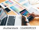 creative graphic designer using ... | Shutterstock . vector #1163039215