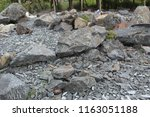 grey crushed stones in close up ... | Shutterstock . vector #1163051188