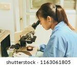 blurred of woman scientist... | Shutterstock . vector #1163061805