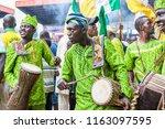 Small photo of IJEBU-ODE, OGUN STATE, NIGERIA- AUGUST 23: Drummers dressed in traditional Yoruba attire perform at the Ojude Oba Festival, August 23, 2018, in Ogun State, Nigeria.