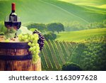 red wine bottle and wine glass... | Shutterstock . vector #1163097628