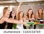 happy  beautiful girlfriends... | Shutterstock . vector #1163116765