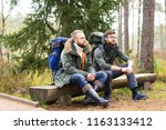 man with a backpack and beard... | Shutterstock . vector #1163133412