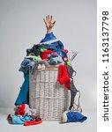 full laundry white wicker...   Shutterstock . vector #1163137798
