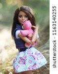 a beautiful barbie with white... | Shutterstock . vector #1163140255
