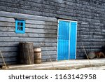 old wooden barrel on the... | Shutterstock . vector #1163142958