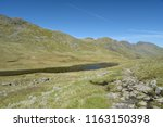 red tarn beneath crinkle crags  ... | Shutterstock . vector #1163150398