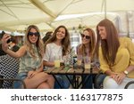 pretty fashionable young girls... | Shutterstock . vector #1163177875
