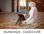 young muslim woman praying in...   Shutterstock . vector #1163211148