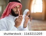 muslim man and woman praying in ...   Shutterstock . vector #1163211205