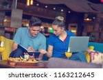 students group eating pizza in...   Shutterstock . vector #1163212645