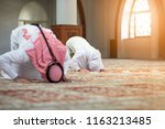 muslim man and woman praying in ... | Shutterstock . vector #1163213485