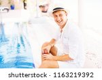 handsome caucasian man relaxing ... | Shutterstock . vector #1163219392