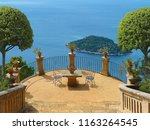 summer holidays on a terrace in ... | Shutterstock . vector #1163264545