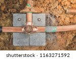 welding copper ground wire on... | Shutterstock . vector #1163271592