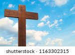 wooden cross on the blue sky... | Shutterstock . vector #1163302315