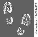 hiking boots footprints.... | Shutterstock .eps vector #1163316175