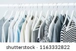 gray clothing on the hangers | Shutterstock . vector #1163332822
