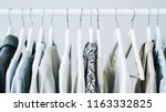 gray clothing on the hangers | Shutterstock . vector #1163332825