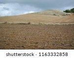 view of a hilltop behind a... | Shutterstock . vector #1163332858