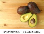top view of ripe avocados both... | Shutterstock . vector #1163352382