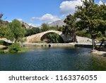 preveli stone bridge a little... | Shutterstock . vector #1163376055