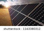 solar panels on the grassland ...   Shutterstock . vector #1163380312