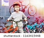boy in helmet chooses with...   Shutterstock . vector #1163415448